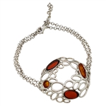 "This lovely sterling silver bracelet highlights 4 pieces of amber. Size is 7"" diameter. Centerpiece is approx 1.5"" x 1""."