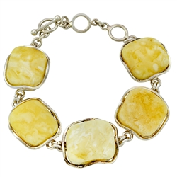 "Classic custard amber cabochons set in a sterling silver frames. 8.25"" long.  The amber is approx .75 square and total weight is 34g."