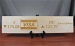 Visa and Johnson & Johnson Ticker Wood Sign