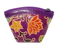 Genuine leather zip-style coin purse.  Multi color floral pattern.