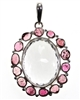 "clear quartz faceted oval stone with 14 pink tourmaline surrounding pebble stones 2-1/4"" commanding piece"