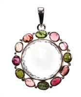 "faceted clear quarz round with mixed color tourmaline pebbles surrounding 1-1/2"" large piece in .925 sterling silver."