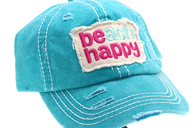 Turquoise ponytail cap says, beach happy
