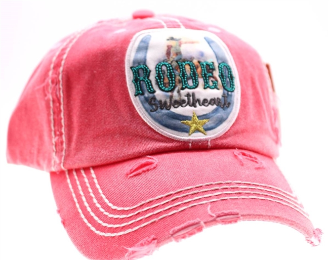 ponytail cap says rodeo sweetheart with horseshoe distressed style coral color