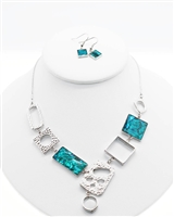 cut-out metal shapes with blue lucite necklace and earrings set.