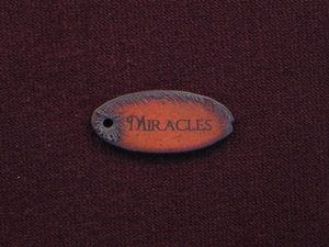 Rusted Iron Oval Miracles Pendant With One Hole
