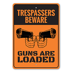 Trespassers Beware Guns are Loaded Sign