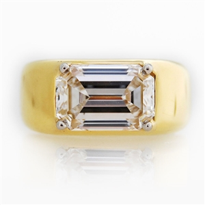 Emerald Diamond Dome Ring, 3.50ct emerald cut diamond is four prong set.