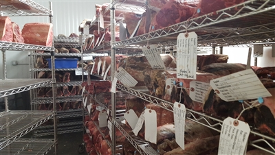 Steak dry-aging in a temperature and humidity-controlled room