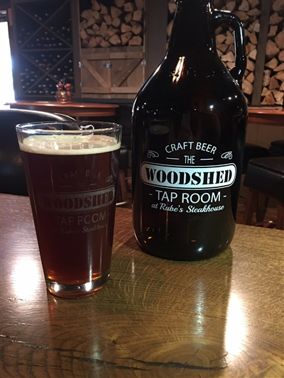 Growler of beer in our Woodshed lounge