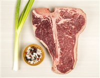 Tbone with seasoning and a green onion
