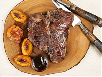 Porterhouse steak with grilled peaches