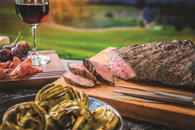Tri-Tip on a platter alongside artichokes and charcuterie. Photo courtesy Certified Angus Beef LLC