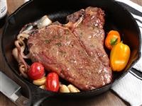 Rube's 20 oz T-bone cooked in a cast iron skillet.