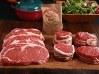 Rube's ribeyes and filet mignon on a wooden platter