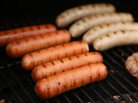 Jumbo hot dogs on the grill