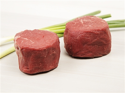 Two tender, raw filet mignon