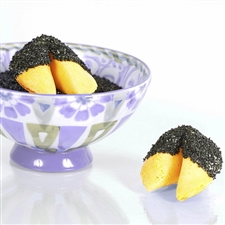 All natural vanilla fortune cookies hand dipped in white chocolate then decked out in black onyx bling.