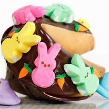 This Easter Gigantic fortune cookie is chocolate covered and decorated with marshmallow Peeps for springing into spring.