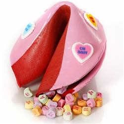 Chocolate covered giant fortune cookie covered with pink tinted chocolate and stuffed with candy hearts. Your edible gift is sure to please especially when filled with good fortune on your personalized message.