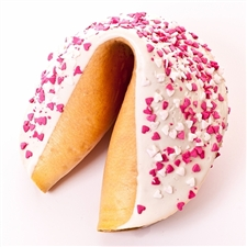 A beautiful gigantic fortune cookie chocolate covered and decorated for Valentine's Day or any day with pink and white hearts. Your fortune cookie message included!
