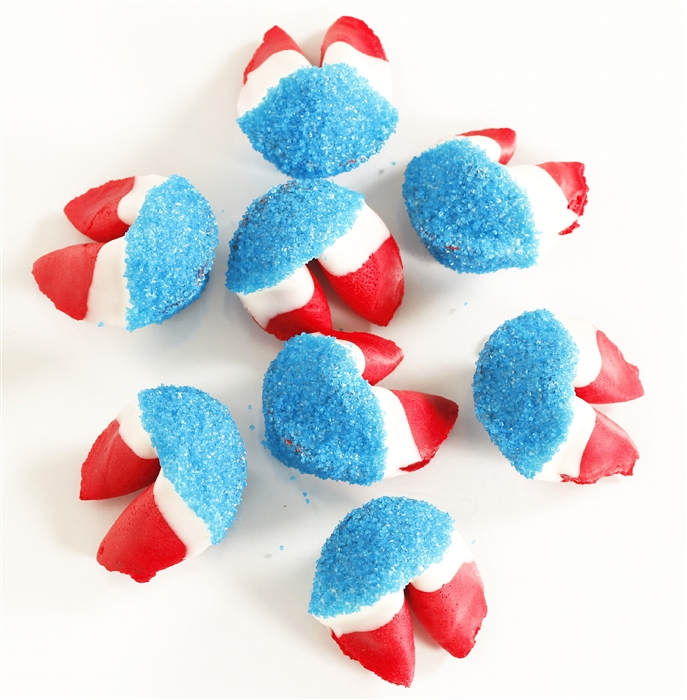 Strawberry flavored fortune cookies dipped in chocolate and blue bling sprinkles make this fortune cookie truly all american.