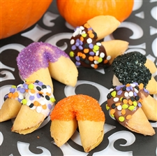 Fortune Cookies with messages for Halloween. These gourmet fortune cookies are dipped in milk, white and dark chocolate then sprinkled with monsterfetti and bling.