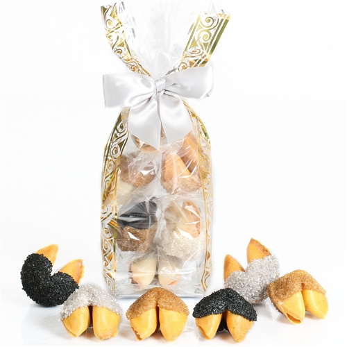 A cello bag containing 6 vanilla fortune cookies hand-dipped in white chocolate and coated in black, silver and gold sugar bling.