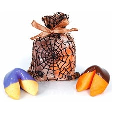 One vanilla fortune cookie dipped in purple chocolate and one orange chocolate covered fortune cookie inside a spooky web organza bag. Each cookie has a Halloween fortune inside.