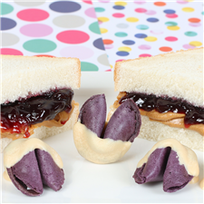 Grape jelly flavored fortune cookies, dipped in peanut butter chocolate with a gooey grape jelly center.