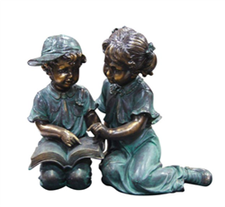 BOY & GIRL READING STATUE