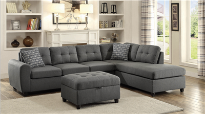 Grey linen sectional sofa with tufted seat backs and reversible chaise lounge
