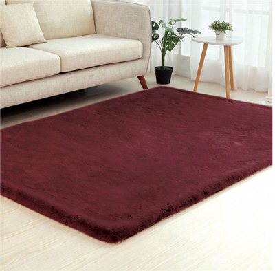 Caparica Faux Chinchilla Area Rug in Wine
