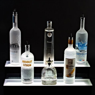 Two Tier Bottle Display with LED lighting and five display bottles on a black background.