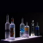Double Wide Bottle Shelf with LED lighting and six display bottles on a black background.