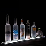 LED Bottle Shelf with a single lighted row and six display bottles on a black background.