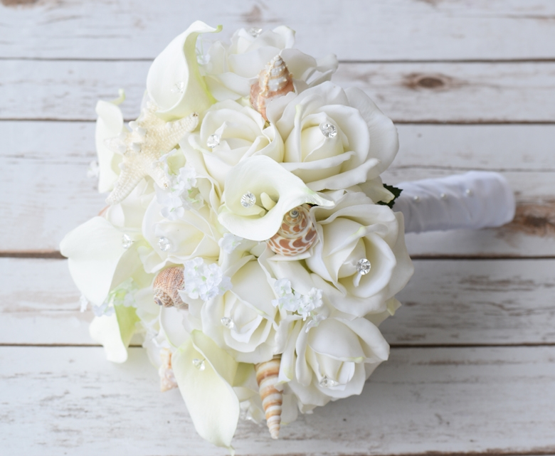 seashells and natural touch off white roses bouquet