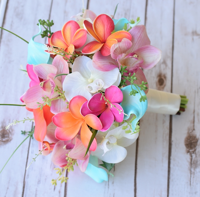 Natural Touch Pink Turquoise And Coral Plumerias And Calla Sprays