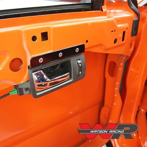 Mustang ROAD RACE INTERIOR DOOR HANDLE MOUNTING BRACKET (2005-14)