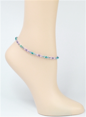 "The ""Royal Sparkle"" Swarovski anklet is crafted with the luxurious round Swarovski Crystal 4mm in shades of purple and aqua with heart chain and sterling silver lobster claw."