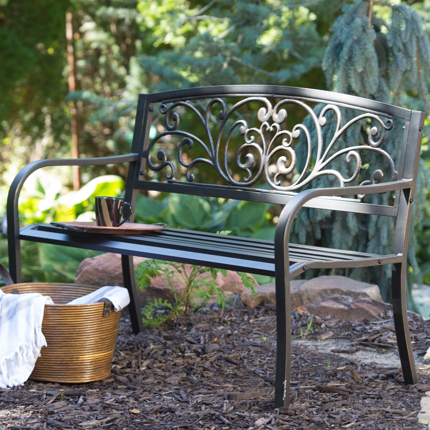 curved metal garden bench with heart pattern in black antique bronze