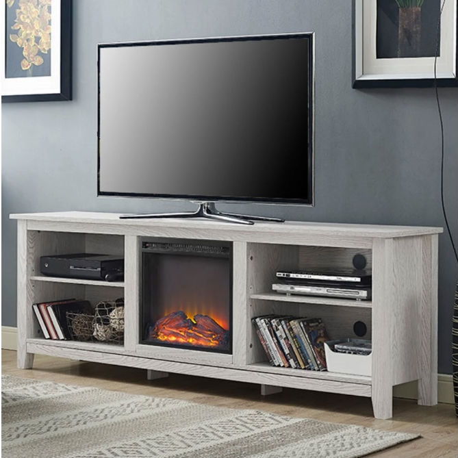 Bring added warmth to any entertaining space in your home with this White Wash Wood 70-inch TV Stand Fireplace Space Heater. Crafted from a combination of sturdy engineered- and solid wood veneer