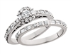 Round & Baguette Diamond White Gold Engagement Ring