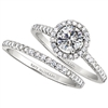 Single diamond halo engagement ring & wedding band
