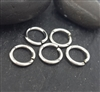 7mm open jump rings (5 ) click and lock sterling silver