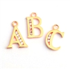 gold on silver zirconia letter charm