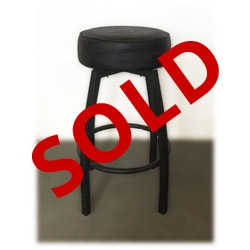 Used black metal bar stool with vinyl cushion and spinning seat top