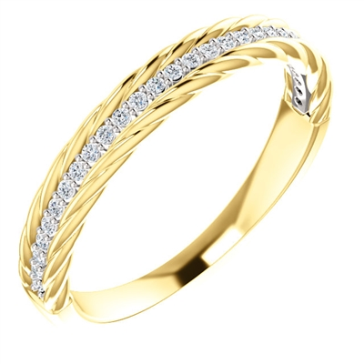 Round diamond accents adorn this 14k yellow and white gold diamond stackable ring, with 1/6 carats of diamond excellence.