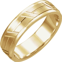A 14k gold men's wedding band with grooves.