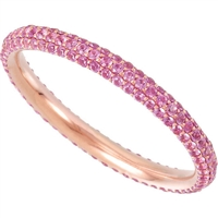 Pink sapphires dance all around this 14k rose gold in this unique and unforgettable stackable ring that plays well with others!